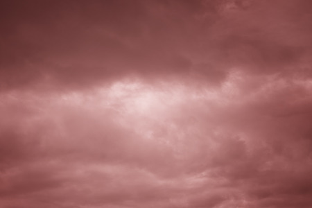 sunligh: Beautiful abstract sky with marsala color clouds. Stock Photo