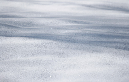 Details of the blured snow texture with shadows. Stockfoto