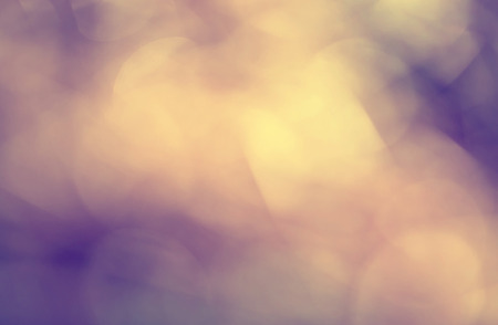 Abstract vintage orange gold and purple color blurry background. Vintage filter effect used. 写真素材