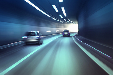 Blurry chromatic color tunnel car traffic motion blur. Motion blur visualizies the speed and dynamics. Stock Photo - 46037998