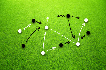 grass field: Soccer game strategy plan concept or football field. Game soccer strategy plan team on sunny green grass background.
