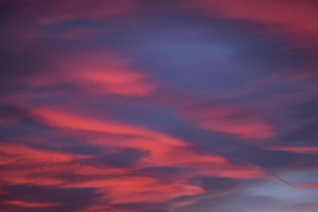 Beautiful winter evening red and violet color dramatic sky with clouds.