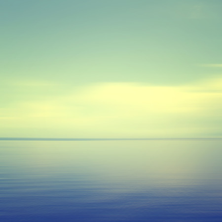 An abstract ocean seascape with blurred panning motion (cyan color effect).