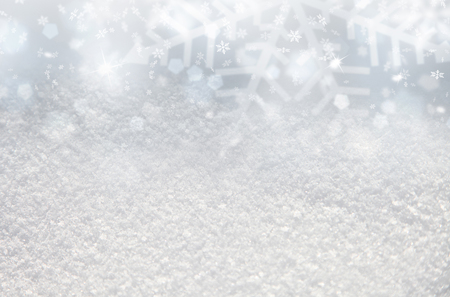 Blurry abstract snow background with added snowflake and sparkle.