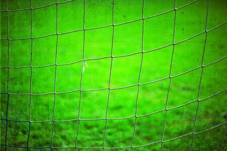 Abstract soccer goal net pattern. Grunge filter effect used. Foto de archivo