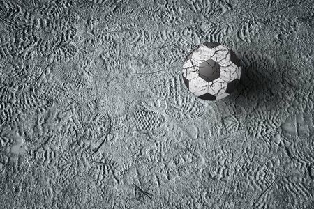 shoeprint: Soccer ball on ground with imprint of shoes.
