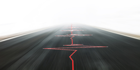 Abstract safe motion blurred high speed vehicle driving with heart health pulse on black asphalt road.
