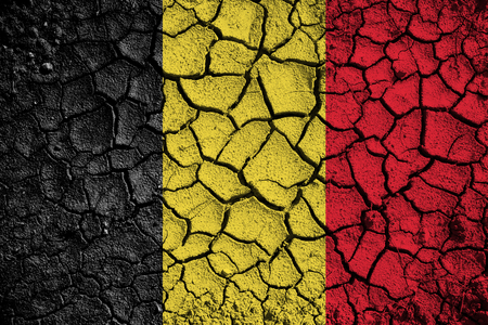 war refugee: Conceptual cracked Belgium flag background.
