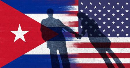 couple holding hands: United States of America and Cuba abstract torn flag background with shadow of couple holding hands. Conceptual and symbolic illustration of the friendly situation between Cuba and USA.