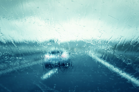 driving conditions: Abstract blurred dangerous highway driving on a rainy day. Bad weather conditions on highway. Stock Photo