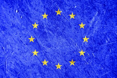 disintegration: European union flag painted on metal damaged background. Conceptual disintegration european union background. Stock Photo