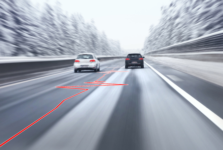 overtaking: Safety car overtaking on highway with heart health pulse on slippery asphalt road. Motion blur visualizies the speed and dynamics.