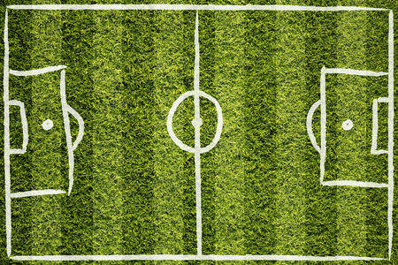 cut the competition: Hand drawn soccer field lines or football field lines on sunny green grass background.