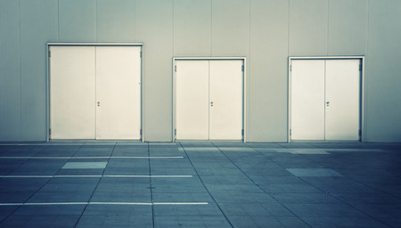 parking facilities: Stainless steel or chrome metal door and metal wall. Stock Photo