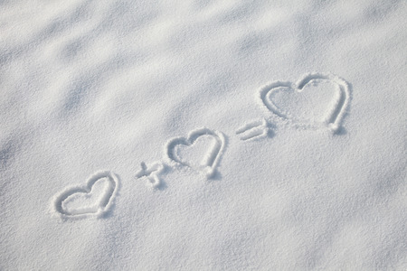 new opportunity: Hearts in the snow.Two small love hearts for new opportunity.