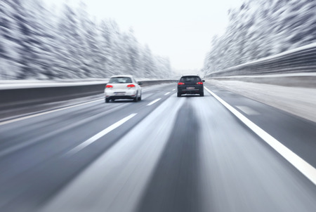 overtaking: Safety car overtaking on highway. Motion blur visualizies the speed and dynamics. Stock Photo