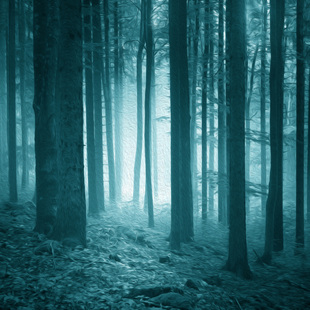 Dreamy artistic turquoise blue colored light in the foggy forest. Oil filter effect used.