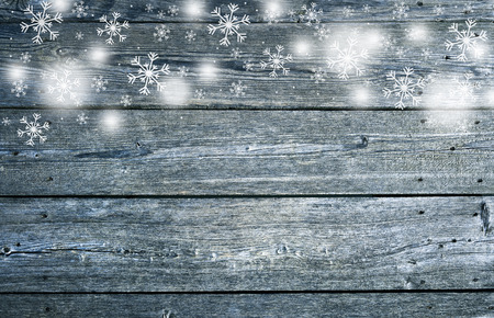 Textured wooden soft blue colored boards with illustrated snowflakes, copy space background. Greeting card background.