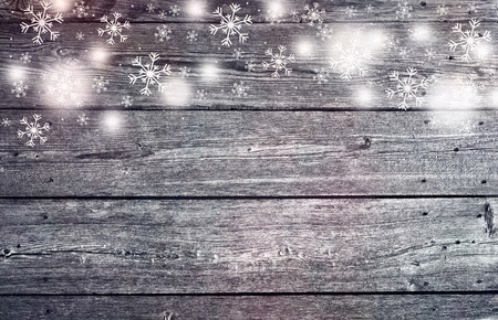 Textured wooden soft red colored boards with illustrated snowflakes, copy space background. Greeting card background. Stock Photo