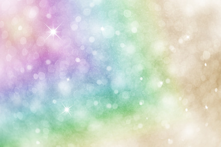 Artistic rainbow colored winter snowfall bokeh background with sparkle. Colorful blurry Christmas and New Year greeting card illustration background with sparkle.
