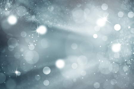 the light rays: Abstract blue color bokeh with light rays background. Cyan blue colored blurry Christmas and New Year greeting card illustration background with sparkle.