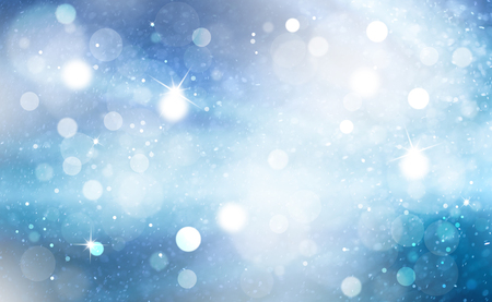 Artistic bright shiny blue color snowy bokeh with light rays background. Abstract blurred Christmas and New Year greeting card illustration background with sparkle. Stock Photo