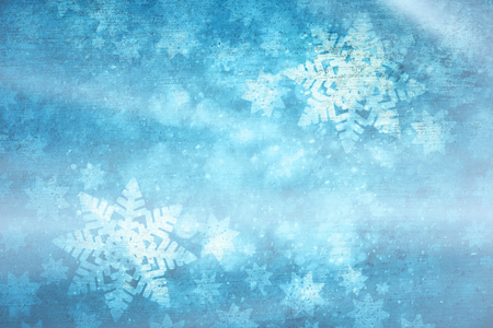 Magical blue colored shiny artistic blurry textured snowflake shapes illustration background. Dreamy winter season copy space greeting card.