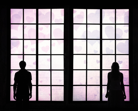 think through: Silhouette of a young couple standing and looking through big window at pink colored valentine heart shapes background.