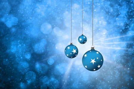 Blue color abstract winter season bokeh with lovely decorative Christmas bulbs set and light rays background. Blue colored Xmas bulbs with star shapes illustration background. Stock Photo