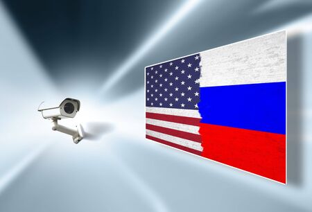 Cctv surveillance camera monitoring and displays United States of America and Russia torn flag on the illustrated screen. Stock Photo