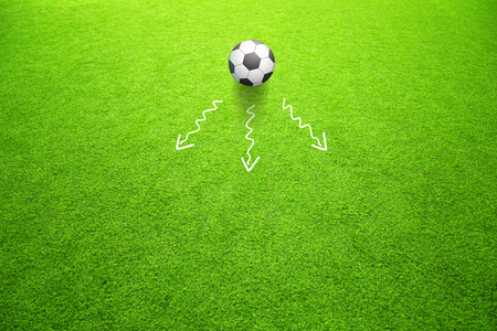 Soccer game strategy plan concept or football field with one soccer ball and the directions of movement. Game soccer strategy plan team on sunny green grass background. Stock Photo