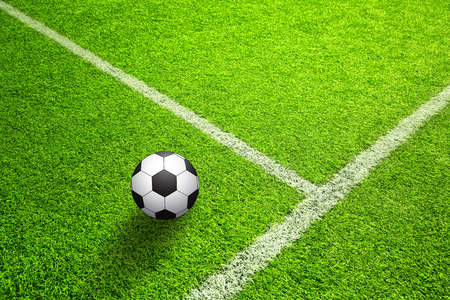 Hand drawn (sketch style) soccer field or football field with illustrated soccer ball on sunny green grass background. Stock Photo