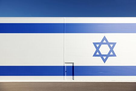 border patrol: Israel flag on new big sunny metal architecture wall with door background. Concept political relations with neighbors.