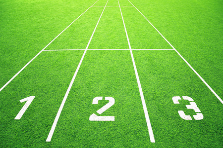 Race track with the numbers on green grass field background.