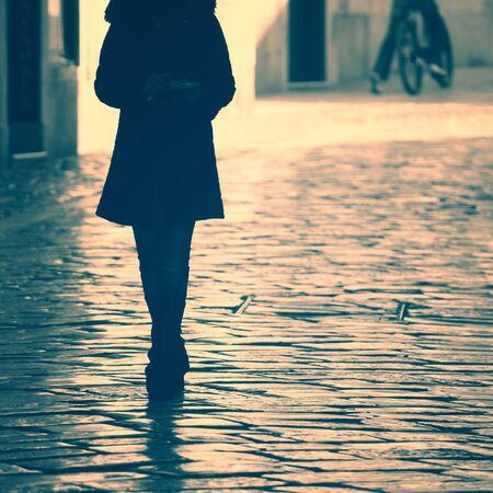 Goodbye women on street. Vintage filter effect used.