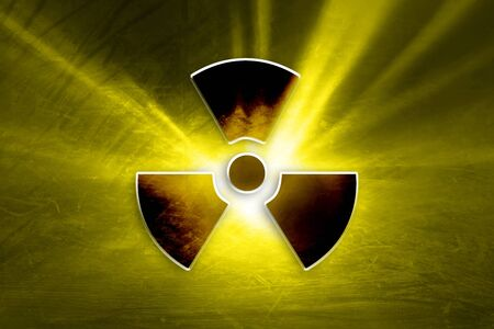 radioactive symbol: Conceptual dark grunge radioactive symbol on the textured yellow colored illustration background.