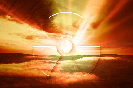 gamma radiation: Dramatic red evening sky with illustrated radiation symbol. Conceptual nature landscape disaster background.
