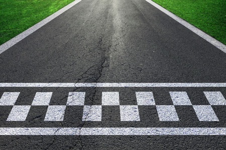 begin: Sunny race road details with finish and start line pattern background.