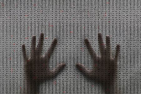 invade: Conceptual computer binary numbers illustration on wet droplet window background with human hands.  Stock Photo