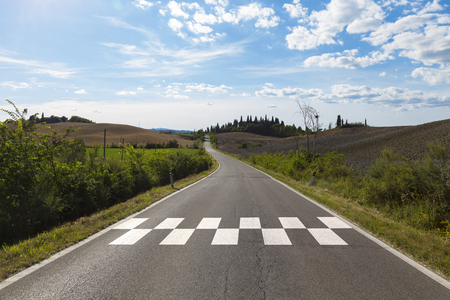 Sunny countryside race asphalt road with finish and start line pattern background.