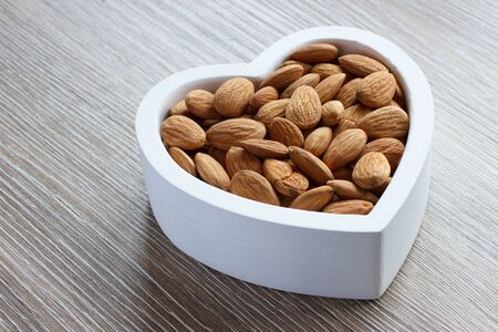 filled: Heart filled with almonds Stock Photo