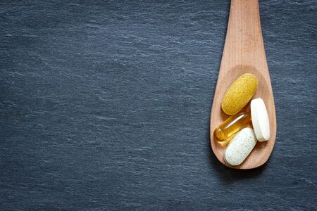 supplement: Healthy supplement on wooden spoon Stock Photo
