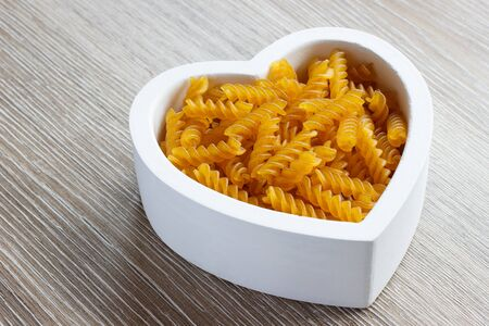 filled: Heart filled with gluten free pasta