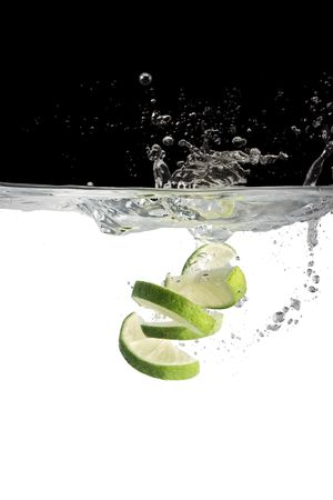 bitter fruit: limes in water Stock Photo