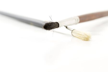 two brushes for artists on white background Stock Photo - 6918876