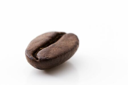 closeup of one coffee bean on white background