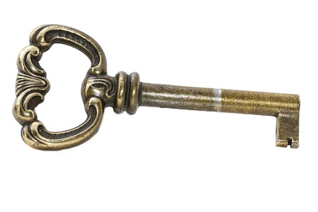 closeup of one used key on white background