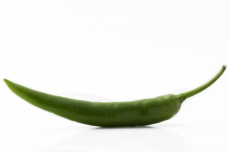 green chilli: one green chili isolated on white background Stock Photo