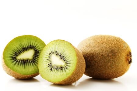 two and a half: one kiwifruit and two half kiwis isolated on white background