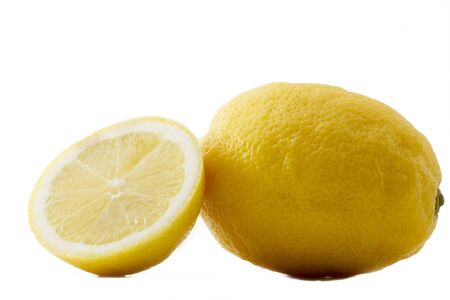 one lemon and a half on white background photo